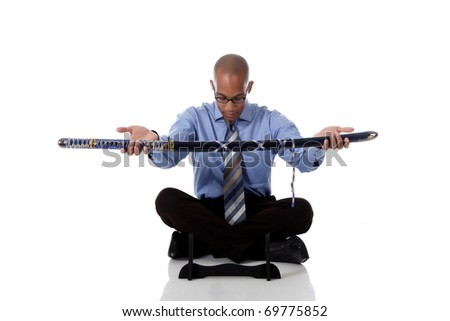 Young handsome African American businessman sitting cross legged and giving the  japanese katana sword. Studio shot. White background. - stock photo