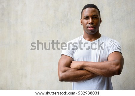 Young handsome African man with arms crossed