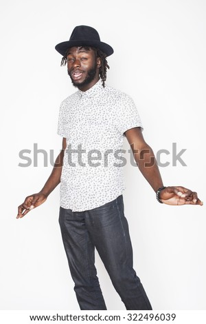 young handsome afro american boy in stylish hipster hat gesturing emotional isolated on white background - stock photo