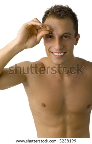 Young, handsome and naked man with tweezers in hand. Smiling and looking at camera. White background, front view
