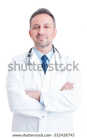 Young handsome and trustworthy male doctor or medic standing with arms crossed isolated on white background - stock photo