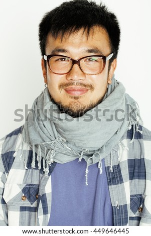 young handsome asian man hipster in glasses on white background smiling, modern lifestyle concept