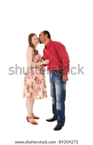 young handsome asian man kissing his beautiful pregnant caucasian wife - stock photo