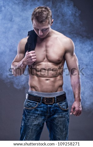 Young handsome athlete - stock photo