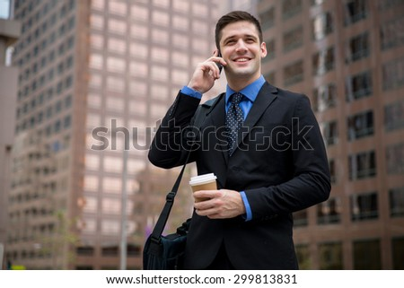 Young handsome attorney on a business call interview new job downtown skyscrapers - stock photo