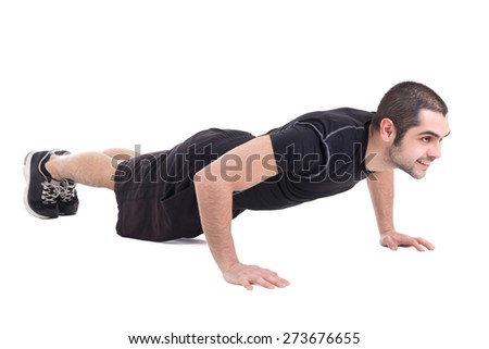 young handsome bearded arabic man in sportswear doing push up isolated on white background