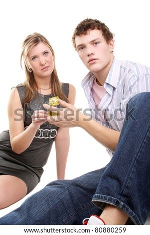 young handsome boy and pretty girl with a gift - stock photo