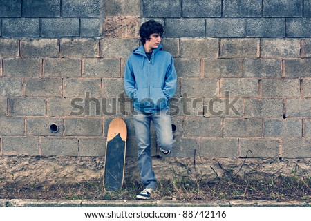 Young handsome boy in urban background - stock photo