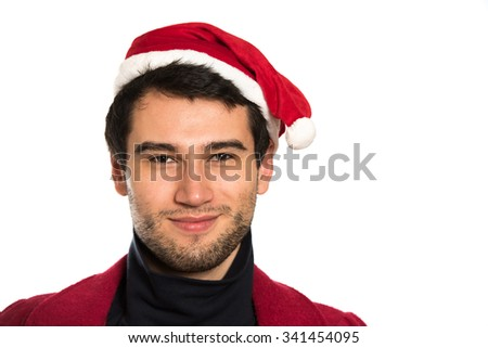Young handsome brunette man wearing red hut, coat and black pullover, smiling, happy, on white background with copy space