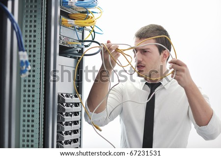 young handsome business man  engeneer in datacenter server room - stock photo