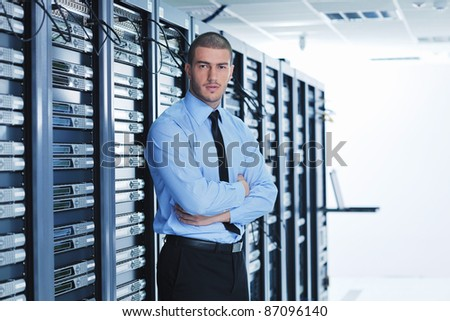 young handsome business man  engeneer in datacenter server room - stock photo