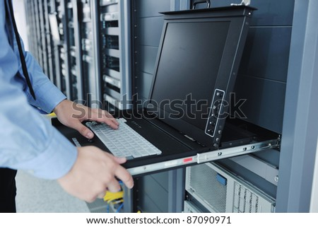 young handsome business man  engineer in datacenter server room - stock photo