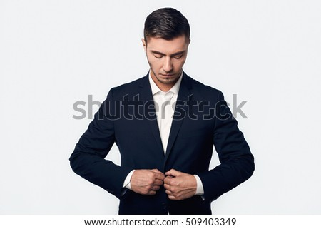 young handsome business man in suit isolated on white background in studio