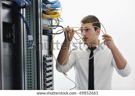 young handsome business man it  engeneer in datacenter server room - stock photo
