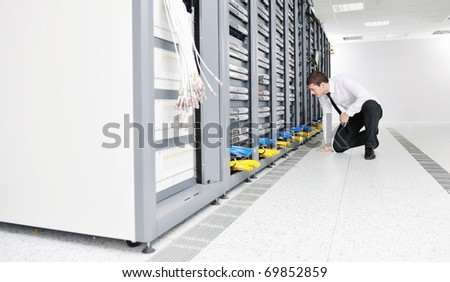 young handsome business man it  engeneer in datacenter server room - stock photo