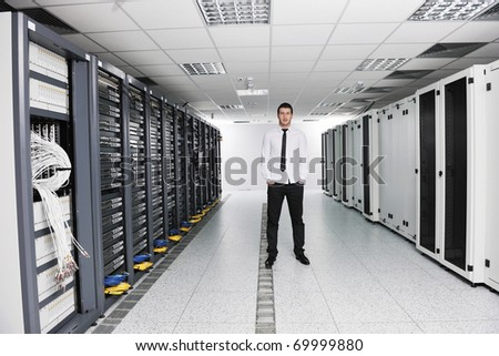 young handsome business man it  engineer in data center server room - stock photo