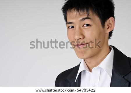 Young handsome business man portrait with smiling expression, closeup. - stock photo