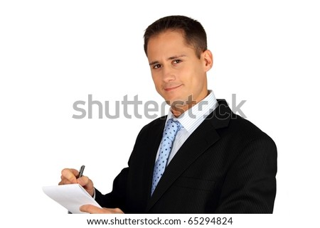 Young handsome business man taking notes - stock photo