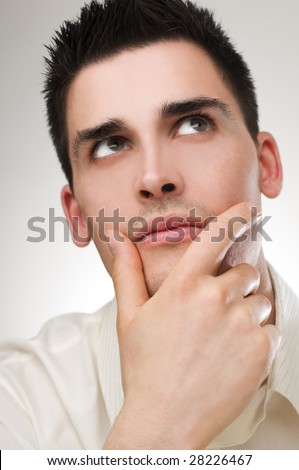young handsome business man thinking close up - stock photo