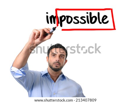 young handsome business man turning impossible word into possible with red marker writing on glass isolated on white background in motivation,  incentive and challenge concept