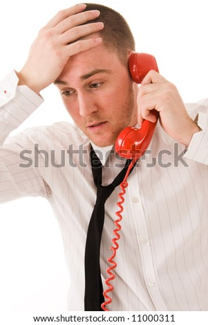 young handsome businessman and red telephone receiver