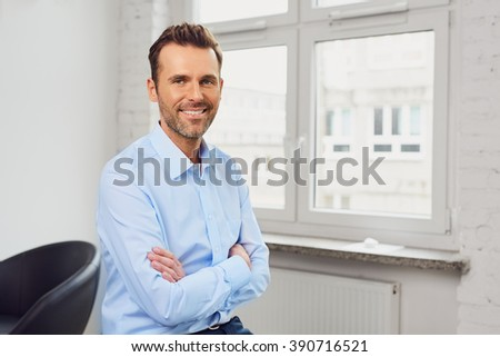 Young handsome businessman at office - stock photo