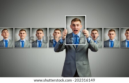 Young handsome businessman expressing different state of mood - stock photo