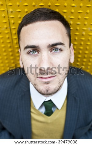 Young handsome businessman from above - stock photo