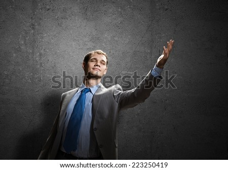 Young handsome businessman gesturing and presenting something