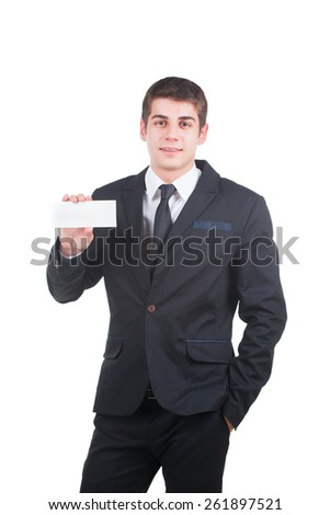 Young handsome businessman holding a blank white paper isolated on white