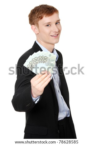 Young handsome businessman holding euros money. Isolated on white background. - stock photo