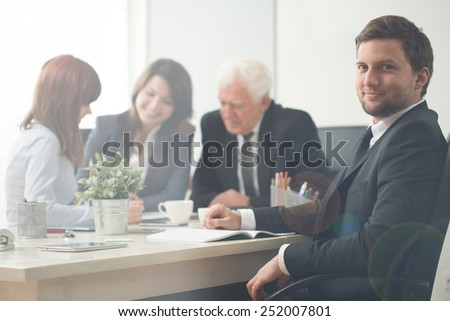 Young handsome businessman in conference room - stock photo