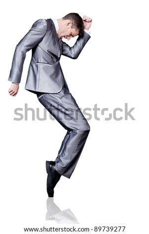 Young handsome businessman in silver suit dancing. Isolated. - stock photo