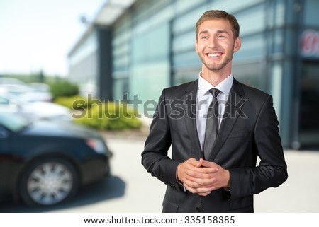 Young handsome businessman smiling