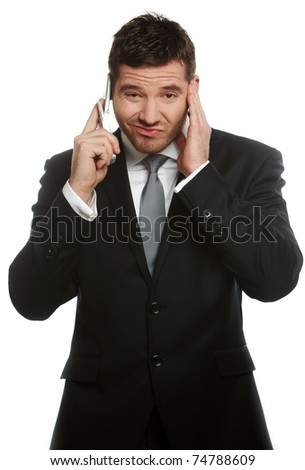 Young handsome businessman talking at the cell phone - stock photo