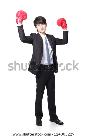 young handsome Businessman win pose with boxing gloves and raise his arms in full length isolated on white background, asian model - stock photo