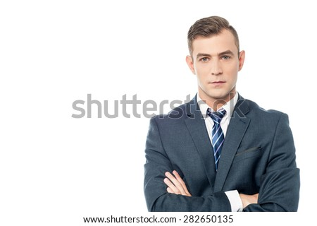 Young handsome businessman with folded arms.