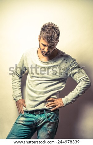 Young handsome casual man over contrast shadow background