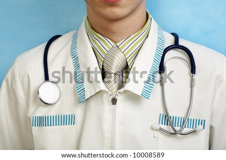 young handsome caucasian doctor with stethoscope (in focus) - stock photo