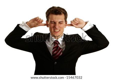 young handsome caucasian man covering ears - stock photo
