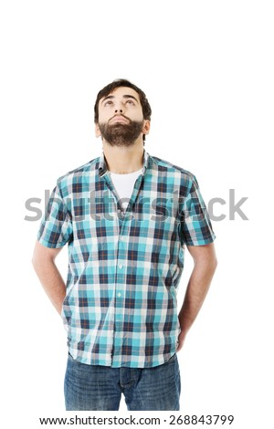 Young handsome caucasian man looking up. - stock photo