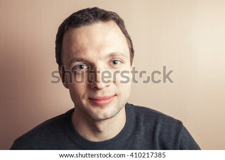 Young handsome Caucasian man portrait, vintage tonal correction, old style photo filter - stock photo