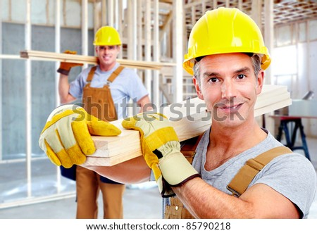 Young handsome contractors  in yellow uniform. - stock photo