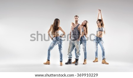 young handsome couple dancing hip-hop, studio background - stock photo
