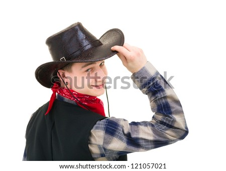 Young handsome cowboy holding his hand on his hat  against isolated white background - stock photo