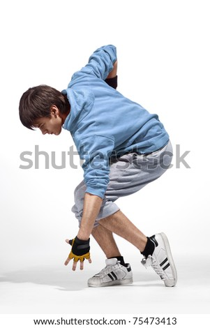 Young handsome dancer wearing stylish sneakers and blue hoodie