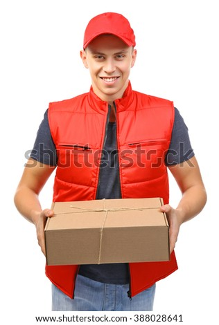 Young handsome delivery man with a carton package, isolated on white - stock photo