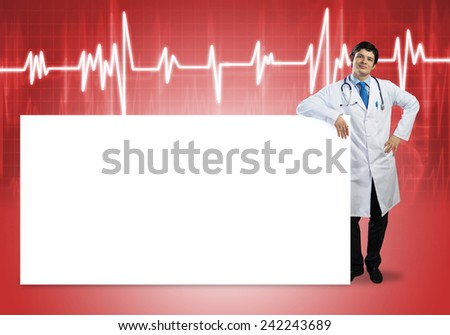 Young handsome doctor with white blank banner. Place your text - stock photo