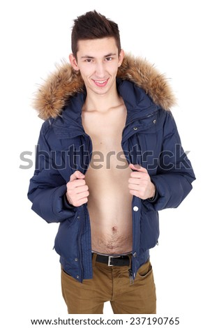 young handsome fashion guy in jacket with furs - stock photo