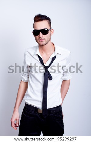young handsome fashion model man posing in white shirt with tie - stock photo